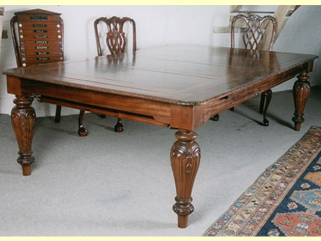 mahogany rollover dining table of French design with ornate carvings